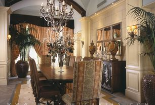 Mediterranean Dining Room with travertine floors, Chandelier, Crown molding, Built-in bookshelf, Wainscotting, Wall sconce