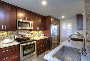 Contemporary Kitchen with Built In Refrigerator, Casement, gas range, Simple granite counters, can lights, Undermount sink