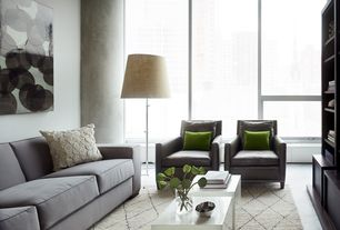 Contemporary Living Room with picture window, Built-in bookshelf, West elm - henry sofa, Casement, Paint, Concrete floors