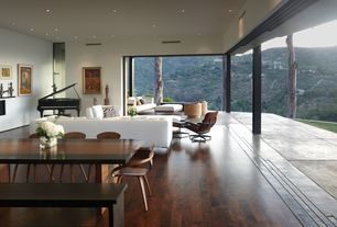 Contemporary Living Room with Columns, Eames lounge chair & ottoman, Telescoping doors, Eames lounge and ottoman
