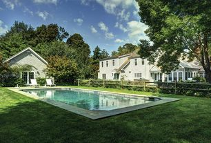 Contemporary Swimming Pool with French doors, Fence, exterior stone floors