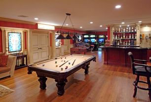 Traditional Game Room with Dynamo Big D Foosball Table, Pac-Man's Arcade Party Cabaret by Namco, Pendant light, Crown molding