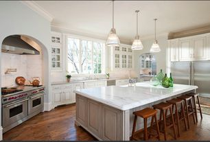 Traditional Kitchen with Crown molding, Pottery Barn Tibetan Bar Stool, Complex marble counters, Farmhouse sink, U-shaped