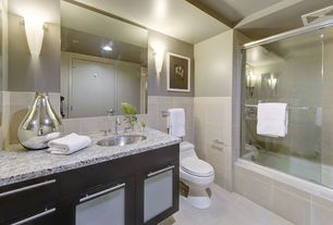 Traditional Full Bathroom with Flush, limestone tile floors, Wall sconce, tiled wall showerbath, Undermount sink, Glass panel