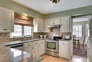 Traditional Kitchen with flush light, High ceiling, Stone Tile, Dura Supreme Cabinetry Oxford Classic Panel, Hardwood floors