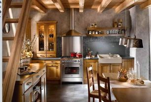 Rustic Kitchen with Wall Hood, stone tile floors, Wood counters, Glazed porcelain floor and wall tile, L-shaped, gas range