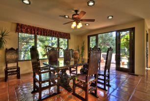 Mediterranean Dining Room with Standard height, Casement, can lights, terracotta tile floors, sliding glass door, Ceiling fan