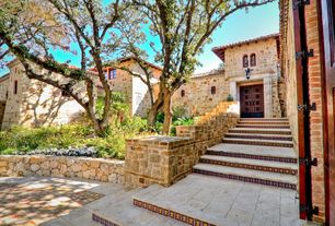 Mediterranean Front of Home with Natural stone exterior wall, Natural stone retaining wall
