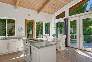 Contemporary Kitchen with European Cabinets, Flush, Limestone counters, Toltec Lighting Stem 1 Light Mini Pendant, Balcony