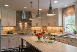 Contemporary Kitchen with Simple marble counters, gas cooktop, full backsplash, Full overlay cabinets, Paint 1, Breakfast bar