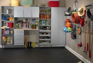 Traditional Garage with Built-in bookshelf, G-floor coin industrial grade midnight black garage floor, Carpet