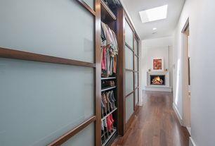 Contemporary Closet with Shoji door, Cement fireplace, Hardwood floors, Skylight