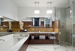 Contemporary Master Bathroom with Rain shower, Pendant light, Double sink, Stainless steel counters, Bathtub, Shower