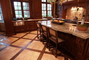 Traditional Kitchen with Breakfast bar, electric cooktop, terracotta tile floors, Standard height, Farmhouse sink, Casement
