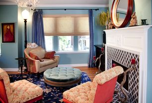 Eclectic Living Room with Stratton 8 light chrome chandelier, double-hung window, Paint, Fireplace, Hardwood floors
