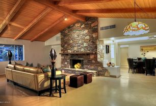 Craftsman Living Room with Cathedral ceiling, stone fireplace, Hardwood floors, Exposed beam