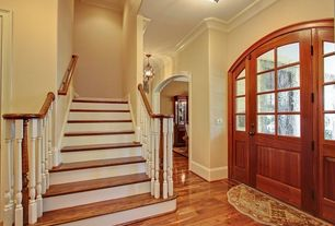 Traditional Entryway with High ceiling, Glass panel door, Paint, flush light, Crown molding, Hardwood floors