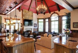 Mediterranean Great Room with Arched window, stone fireplace, Exposed beam, Wainscotting, Chandelier, High ceiling