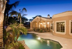 Mediterranean Swimming Pool with Transom window, French doors, exterior stone floors