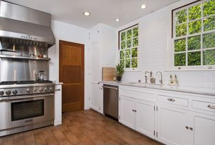 Traditional Kitchen with can lights, gas range, six panel door, dishwasher, Large Ceramic Tile, L-shaped, Casement, Wall Hood