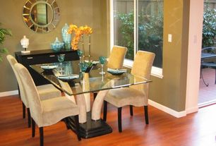 Modern Dining Room with Laminate floors, French doors