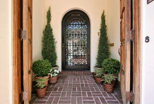 Mediterranean Front Door with French doors, six panel door, exterior brick floors