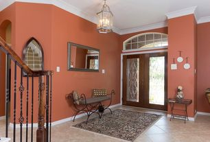 Traditional Entryway with Transom window, Arched window, Standard height, Wainscotting, Chandelier, Carpet, Crown molding