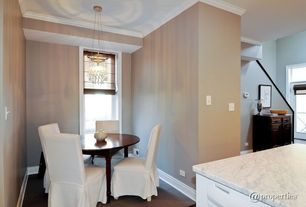 Contemporary Dining Room with Hardwood floors, Crown molding, Chandelier, Carpet