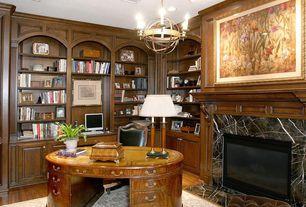 Traditional Home Office with Carpet, stone fireplace, Art desk, Built-in bookshelf, Chandelier, Laminate floors