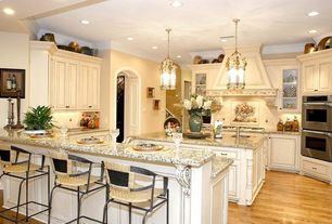 Traditional Kitchen with Kitchen island, Breakfast bar, Pendant light, Pental delicatus polished granite, Glass panel