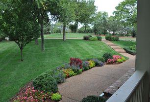 Traditional Landscape/Yard with Raised beds, Pathway, Deck Railing, exterior concrete tile floors, exterior tile floors