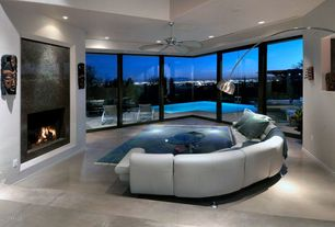 Modern Living Room with Concrete floors, insert fireplace, can lights, picture window, High ceiling, Sunken living room