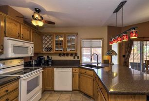 Country Kitchen with Simple granite counters, limestone tile floors, Glass panel, Paint 2, Flat panel cabinets, Pendant light