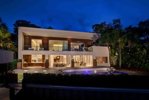 Contemporary Exterior of Home with Outdoor pool, Fence, Gate, Outdoor kitchen, Inground pool