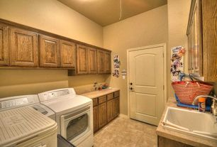 Craftsman Laundry Room with Built-in bookshelf, travertine tile floors, specialty door