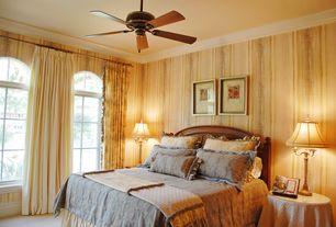 Traditional Guest Bedroom with Ceiling fan, Standard height, Carpet, Crown molding, Arched window, picture window