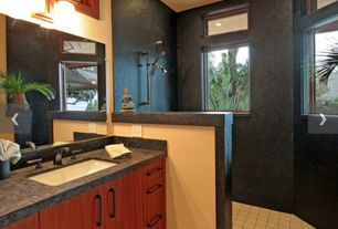 Tropical 3/4 Bathroom with wall-mounted above mirror bathroom light, large ceramic tile floors, Shower, Soapstone counters
