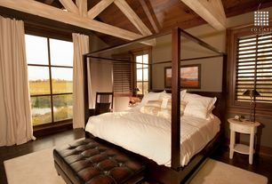 Country Master Bedroom with Wood frame canopy bed, picture window, Casement, Exposed beam, Paint, Laminate floors