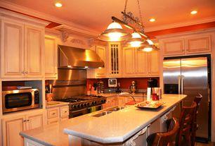 Traditional Kitchen with Raised panel, Pendant light, Kitchen island, Simple Granite, L-shaped, Breakfast bar, Flush