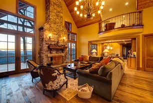 Rustic Living Room with Cathedral ceiling, Fireplace, Wall sconce, Hardwood floors, Loft, Chandelier, six panel door