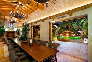 Tropical Dining Room with Aspen collection eight light chandelier, Chandelier, Cement fireplace, Interior flagstone flooring