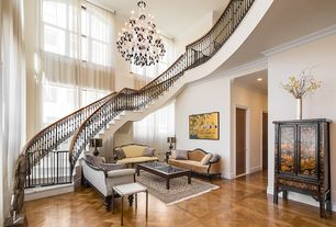 Traditional Staircase with curved staircase, Crown molding, Arched window, picture window, Cathedral ceiling