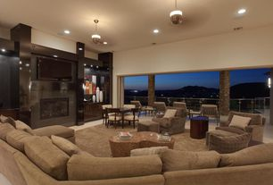 Contemporary Living Room with stone fireplace, Pendant light, sandstone floors, can lights, High ceiling, Fireplace