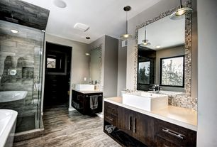 Contemporary Master Bathroom with Master bathroom, Ceramic Tile, Pendant light, Walk in closet, Vessel sink, Corian counters