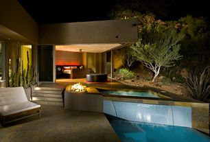 Contemporary Hot Tub with Fountain, Fence, exterior stone floors