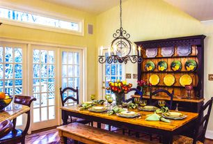 Country Dining Room with Hardwood floors, picture window, High ceiling, French doors, Crown molding, specialty door