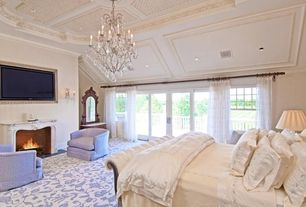 Traditional Master Bedroom with Chandelier, Cement fireplace, French doors, Crown molding, Wall sconce, Carpet