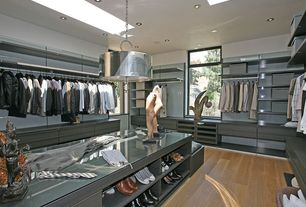 Contemporary Closet with Laminate floors, Skylight, Built-in bookshelf, Industrial steel bolted pendant chandelier