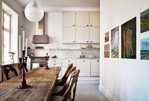 Eclectic Dining Room with Standard height, Casement, Pendant light, Crown molding, Hardwood floors