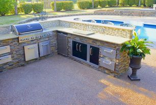 Traditional Patio with Fire pit, exterior tile floors, Outdoor kitchen, Fence, Raised beds